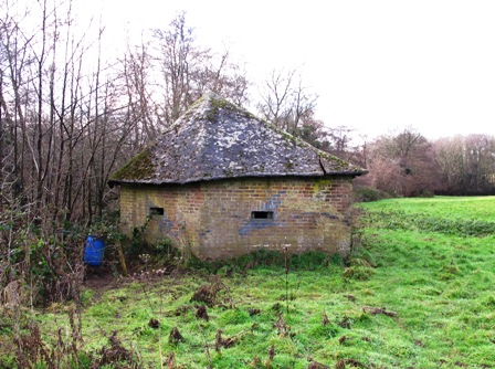 A Shellproof Type 24 at Buxted facing the River Uck, this pillbox has a pitched roof made from a thin concrete based mix supported by timbers . The defence still bears traces of disruptive camouflage painting. It was reportedly constructed by a firm that specialised in building farm barns. Pic by Tim Denton.