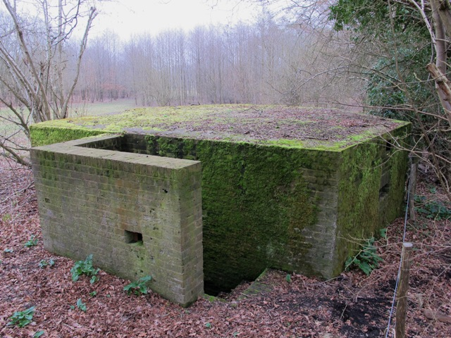 A Shellproof Type 24 Pillbox with entrance protected by an L shaped blastwall, Slaugham, West Sussex.