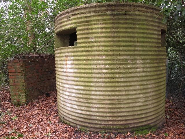 An excellent surviving example of a Type 25 with rare detached and curved blastwall. This pillbox survives in Aldershot, Hampshire. Pic  by Tim Denton