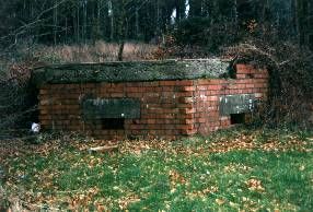 HALF BURIED PILLBOX on the Maiden Newton to Poole Harbour Stop-line, West Dorset