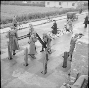 Home Guard soldiers in York prepare a roadblock by inserting metal girders into pre-dug holes in the road, 2 November 1941. Part of WAR OFFICE SECOND WORLD WAR OFFICIAL COLLECTION H 15191