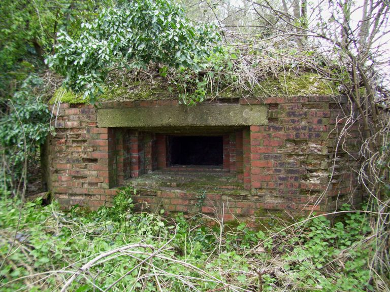 An unsual brick shuttered main embrasure on this Vickers emplacement at Bridgefield, Farnham Surrey