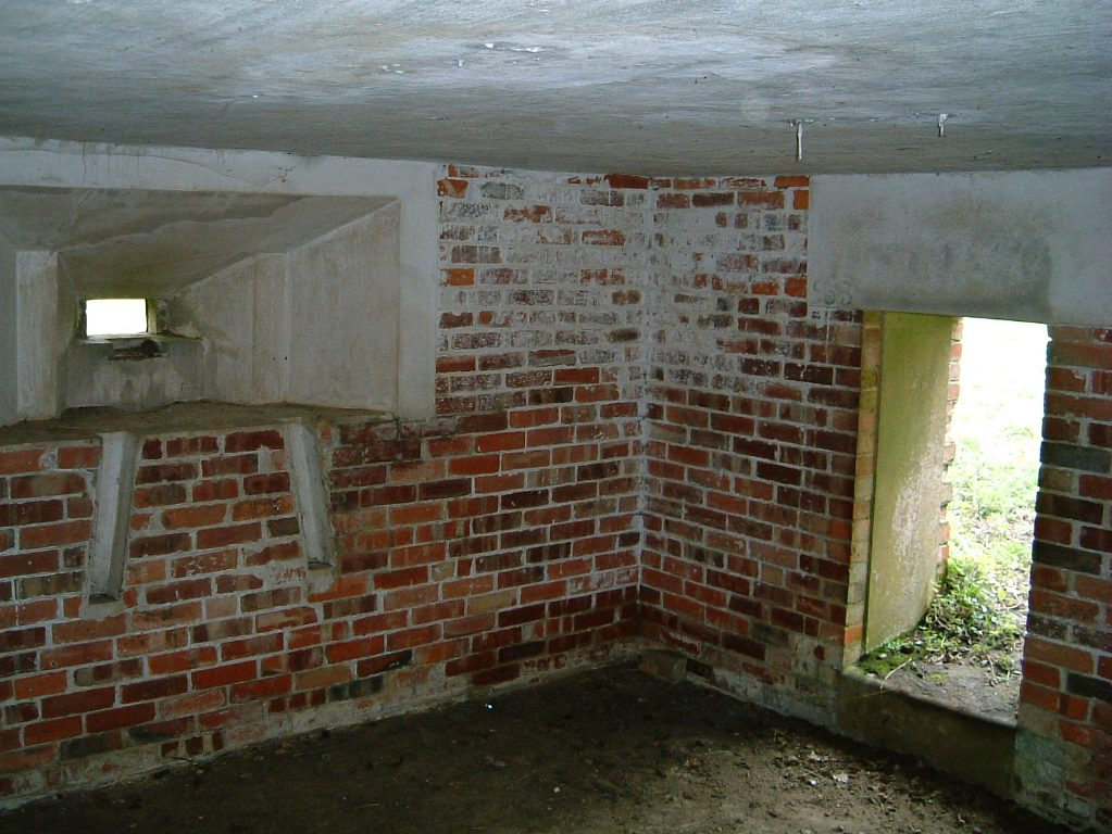 Inside view showing low doorway and side loophole, note Bren gun tripod leg slots