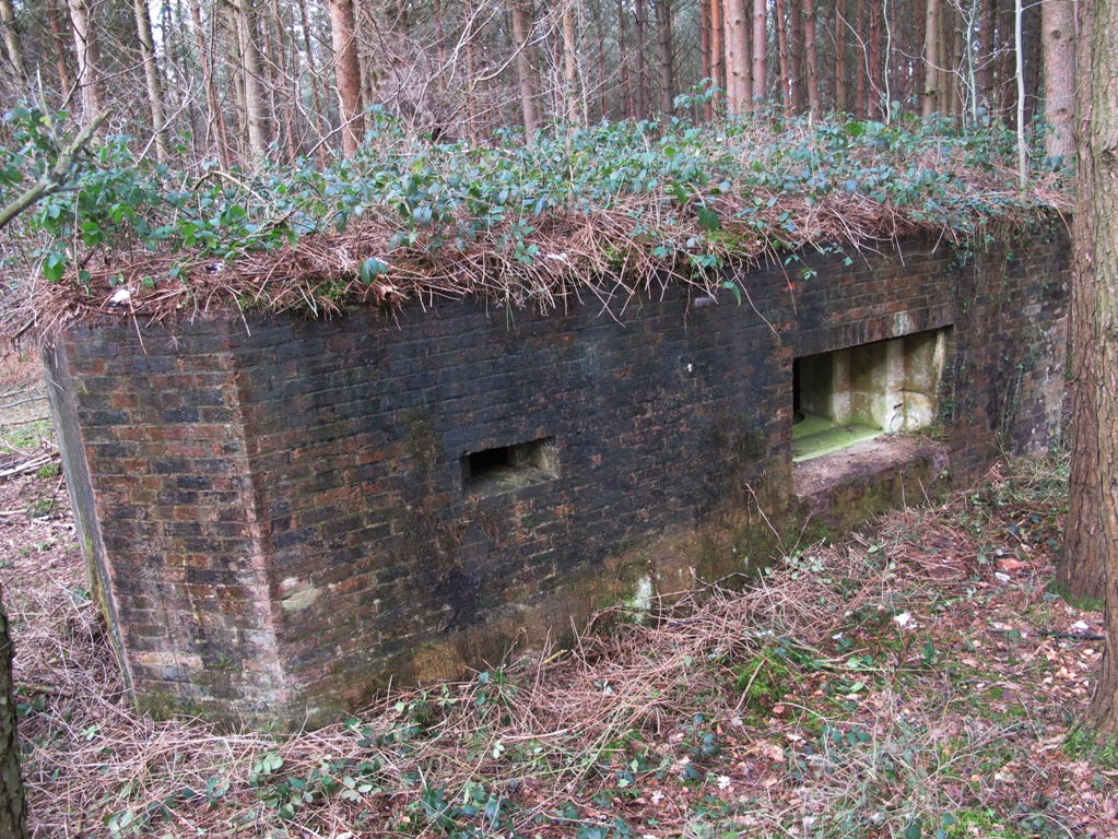 Front of pillbox showing seperate chamber loophole and main QF 6 Pdr embrasure
