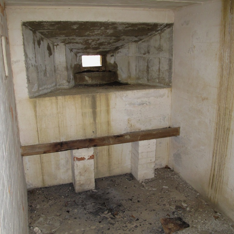 Inside the Bren gun annex showing gun tripod platform, note the original whitewash walls
