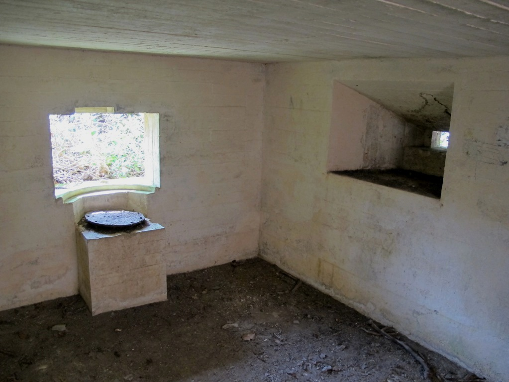 Main 6Pdr embrasure with plinth and metal holdfast plate, note side loophole and original white washed walls