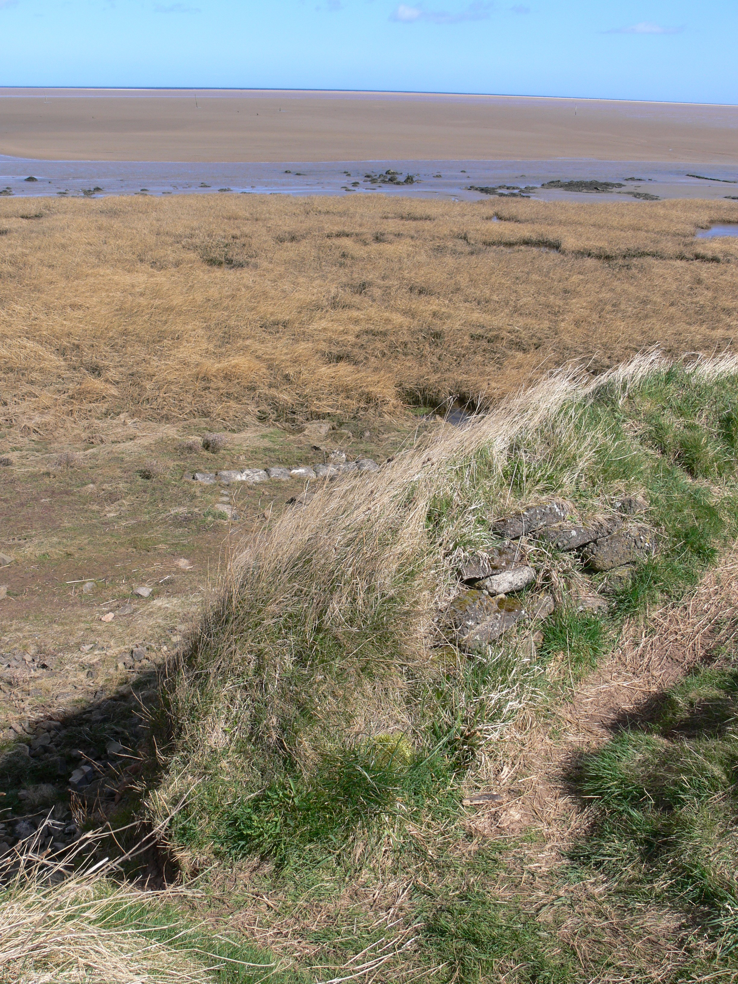 Holy Island Causway North concrete sandbags and Trench