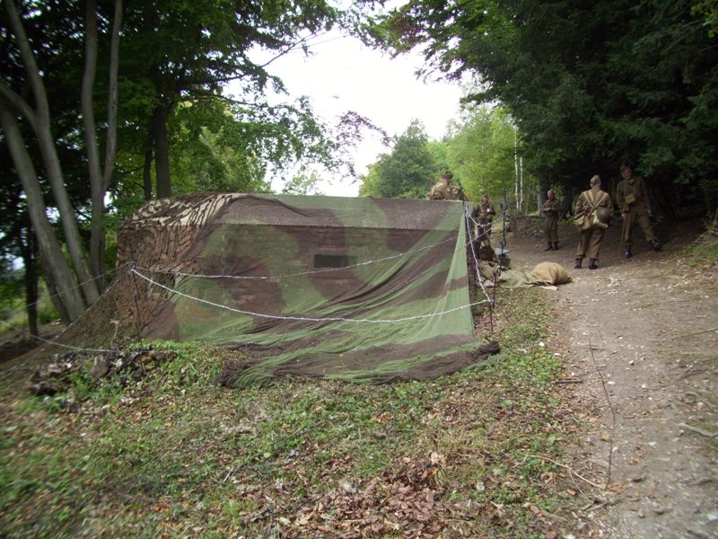 Camouflage netting conceals the side of the pillbox