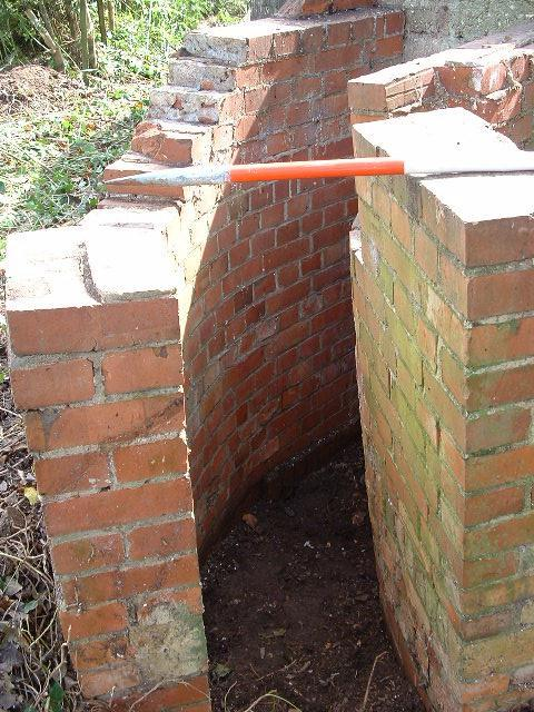 """The curved protection entrance walls that make this pillbox so unique. They are 8`2"""" long and only 1`5"""" wide!"""
