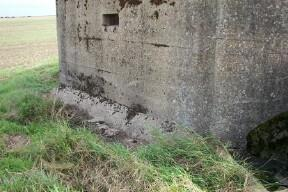 Base of Pillboxes in this area of Essex all have chamfered section around edge. Drainage pipe is to the right of loop about 2 feet down,
