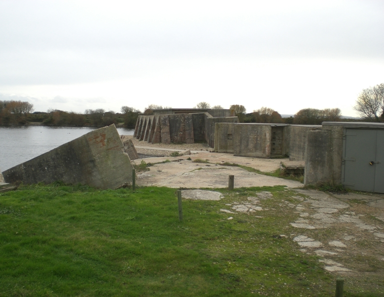 View of tool and ordnance lockers and ruined emplacement