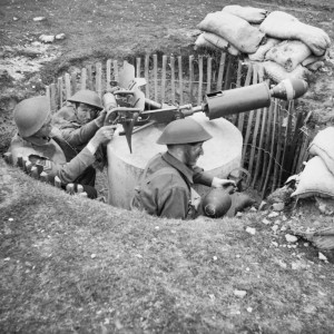 Home Guard soldiers operate a 'Blacker Bombard' spigot mortar during training at No. 3 GHQ Home Guard School at Onibury near Craven Arms in Shropshire, 20 May 1943. Copyright IWM  WAR OFFICE SECOND WORLD WAR OFFICIAL COLLECTION.Catalogue number H 30181. Creator Taylor (Lt) War Office official photographer.