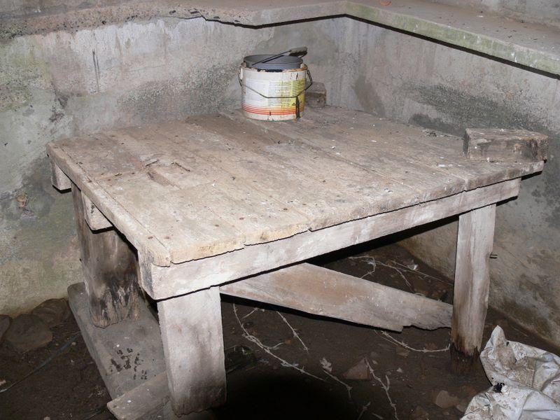 Wooden machine gun table inside Beal Farm Square Pillbox