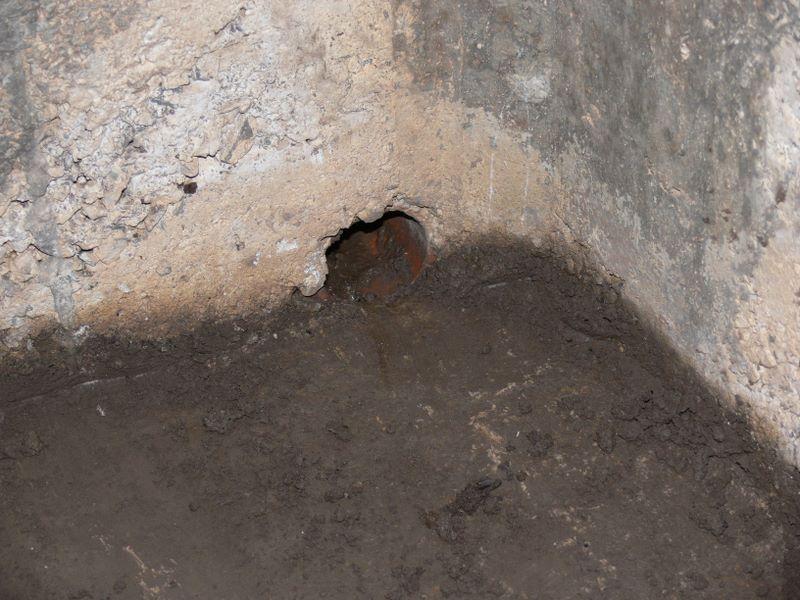 Drain in corner - leading to main drain.