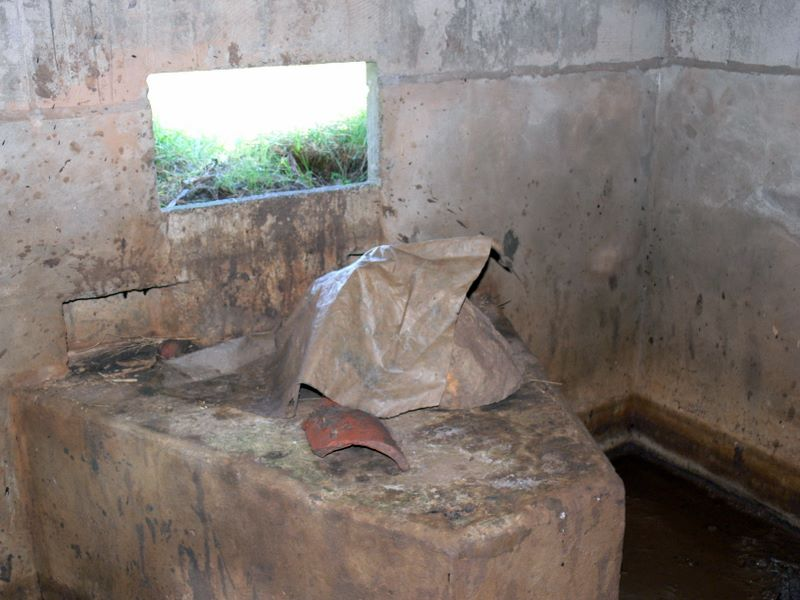 Smaller pillbox with complete gun table and mud.