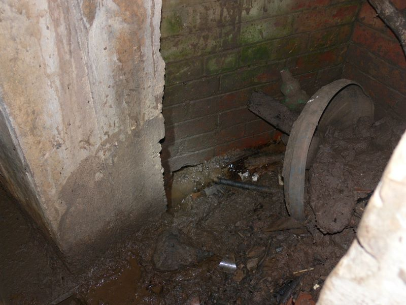 Bottom of emergency stairway - Main drainage area full of rubbish/mud.