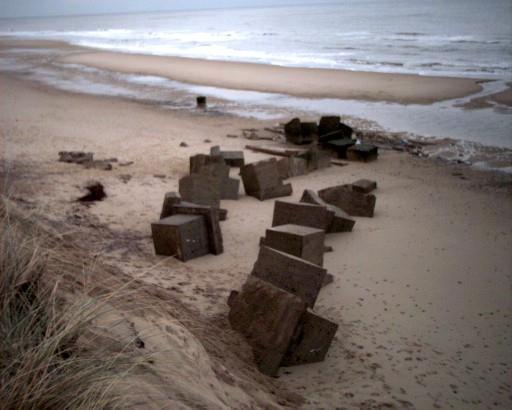 Anti-tank 'Dragons Teeth' on the beach with the Spigot Mortar Base.