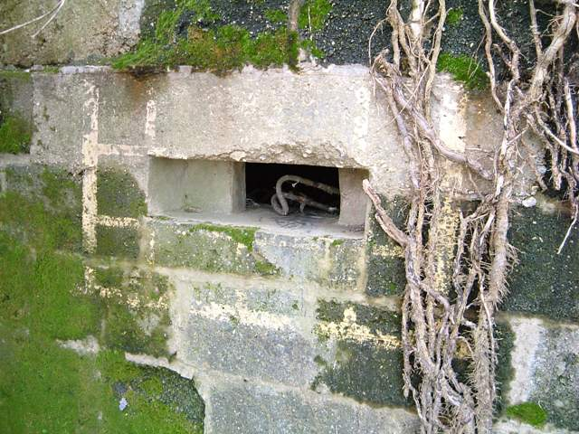False window frame painted around the Loophole on the side of a Type 26 Pillbox at Axminster Ngr SY290980. Picture by Tim Denton 2004.