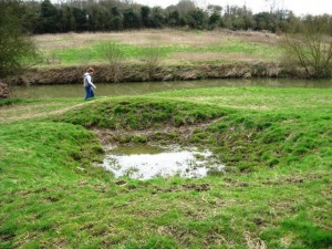 Bomb crater beside the footpath on the River Medway, Teston. Picture by David Ottway.