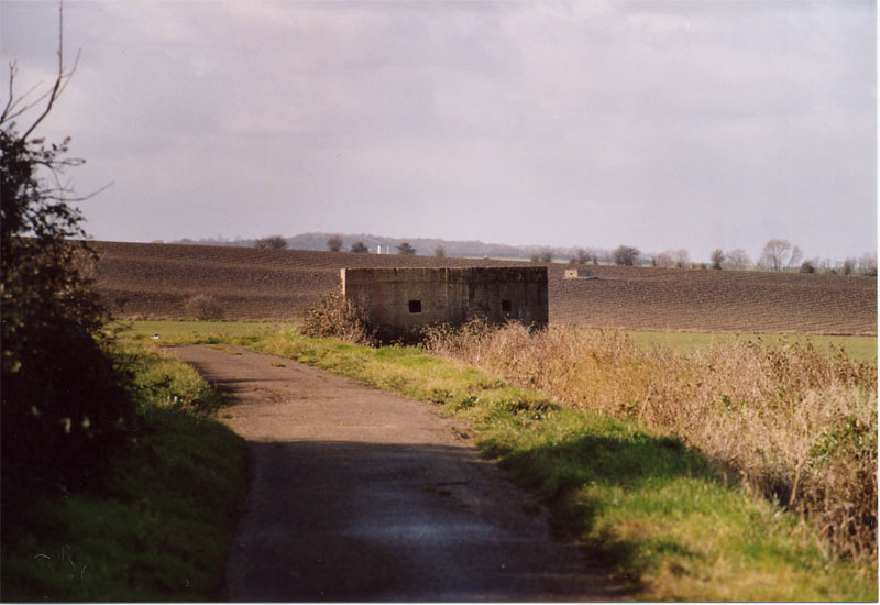 Pillbox No.1 at Allhallows. Although the box is easily accessible, the entrance has been bricked up.  Box 4 is in the background.