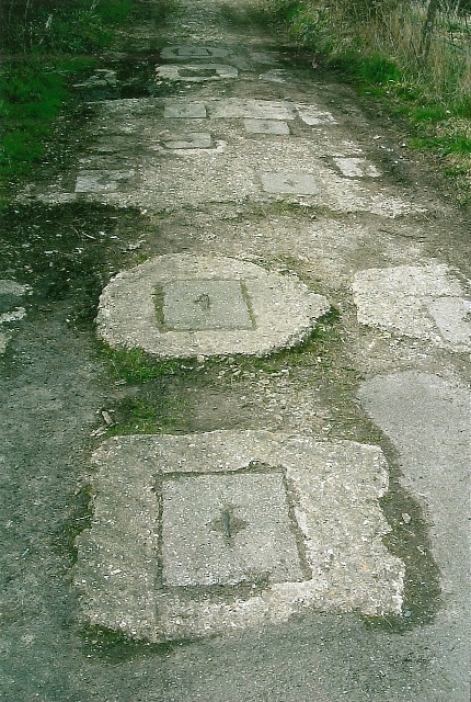 Roadblock sockets still in place with the removable covers. Unrecorded site at Axminster, Devon. Pic by Tim Denton 2003.