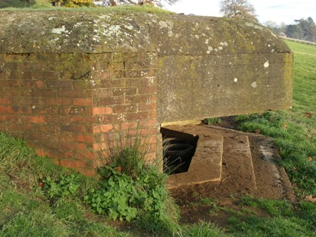 Side on view showing thick overhanging embrasure extension.