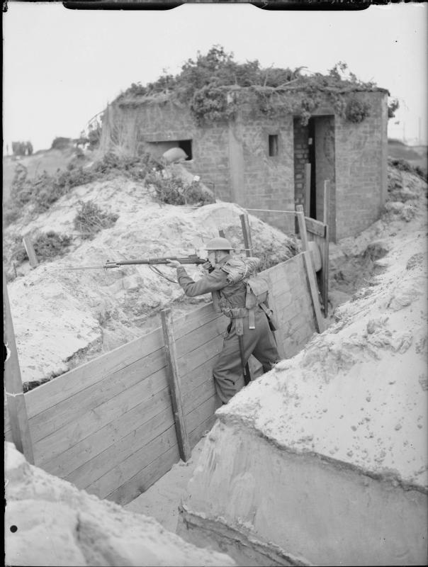 A soldier of the 4th Battalion, The Royal Norfolk Regiment, mans a trench near a pillbox at Great Yarmouth, 31 July - 2 August 1940 H 2702  Part of WAR OFFICE SECOND WORLD WAR OFFICIAL COLLECTION  Subject period Second World War  Alternative Names object category: Black and white  Creator War Office official photographer  Category photographs