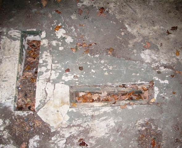 Two position gun trail slots for the 2 Pounder Anti Tank weapon in floor of a Twin FW3/28 Pillbox, Sulham Valley, Berkshire. Picture by Tim Denton.