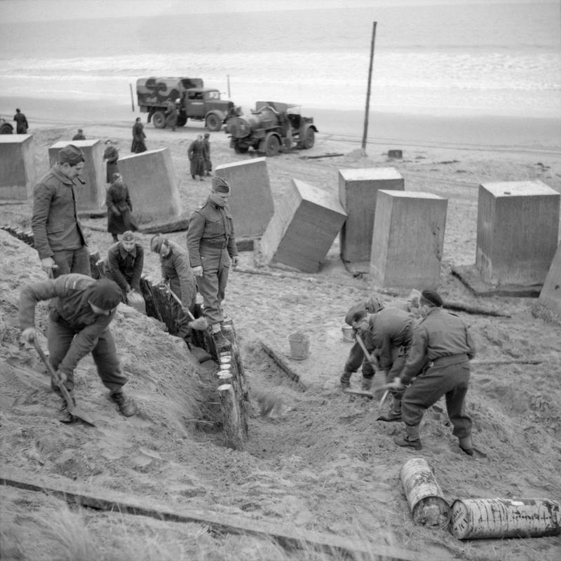 Engineers of the 1st Rifle Brigade (1st Polish Corps) constructing beach defences at Tentsmuir in Scotland. The concrete blocks were used as anti-tank obstacles. THE POLISH ARMY IN THE UNITED KINGDOM, 1940-47. © IWM (H 5493) IWM Non Commercial Licence