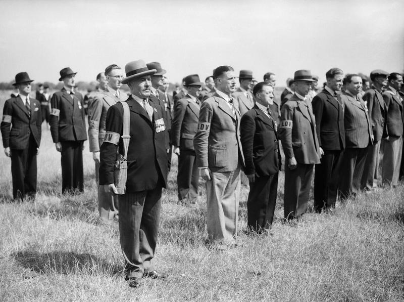 Local Defence Volunteers: 'Old Contemptibles' in the Local Defence Volunteers lined up for inspection. None of the men pictured wear any official uniform except for the LDV armband. THE HOME GUARD 1939-1945. © IWM (H 2005) IWM Non Commercial Licence