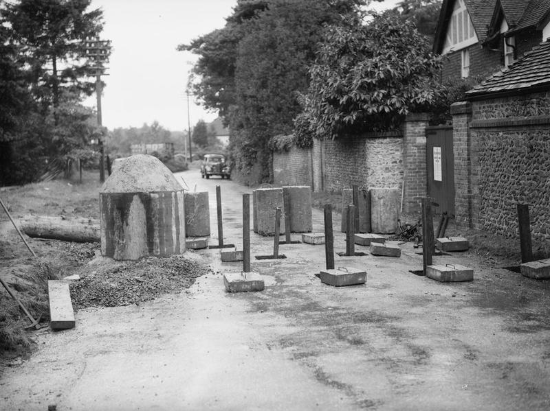 Tank traps in a street in Farnham, Surrey. ANTI-INVASION DEFENCES IN BRITAIN DURING THE SECOND WORLD WAR. © IWM (H 2465) IWM Non Commercial Licence