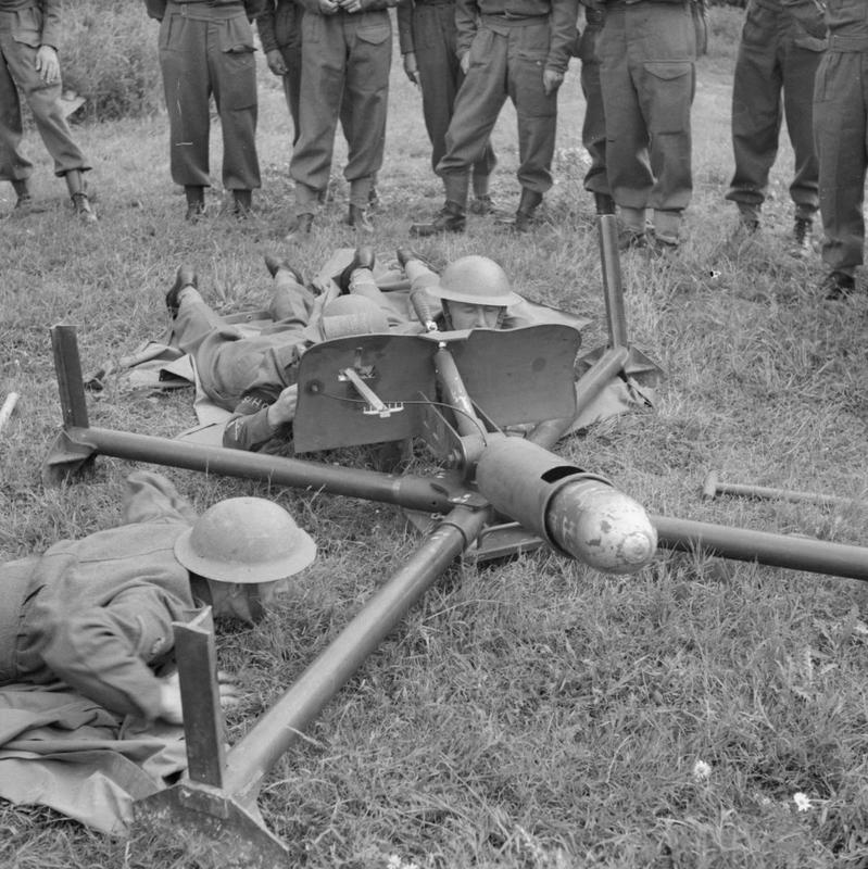 Men of the Saxmundham Home Guard prepare to fire a 'Blacker Bombard' during training with War Office instructors, 30 July 1941. The weapon was a 29mm spigot mortar, designed by a Lieutenant Colonel V V S Blacker, and could fire a 20lb bomb some 900yds. THE HOME GUARD 1939-45. © IWM (H 12299) IWM Non Commercial Licence