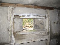 Inner loophole showing shelf and wooden batten for curtain attachment.