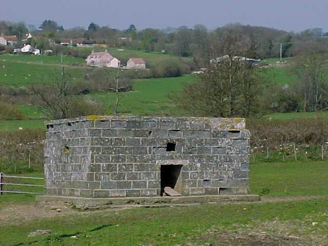 This style of Type 26 Pillbox built to shellproof specification using breeze block shuttering can be found close to the railway line on the Taunton Stop line.